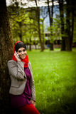 Muslim woman talking on the phone and using technology. Muslim woman is using smart phone Royalty Free Stock Image