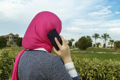 Muslim woman talking on the phone. Stock Photos