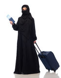 Muslim woman with ticket, passport and travel bag Royalty Free Stock Image
