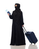 Muslim woman with ticket, passport and travel bag Stock Photos