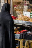 Muslim woman with traditional chador on the street Royalty Free Stock Images