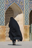 Muslim woman with traditional chador on the street Stock Photo