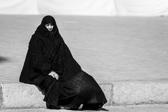 Muslim woman with traditional chador on the street Stock Image