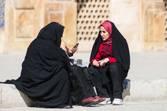 Muslim woman with traditional chador on the street Stock Images