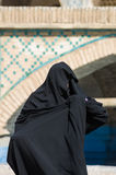 Muslim woman with traditional chador on the street Royalty Free Stock Image