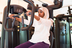 Muslim Woman is Training in Gym Stock Photo