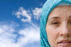 Muslim woman under the sky Stock Photos