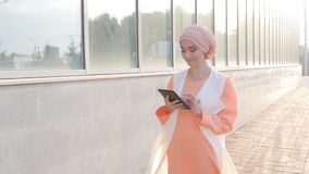 Muslim woman use tablet stock video footage