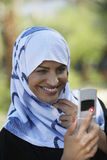 Muslim Woman Using Cell Phone Stock Images
