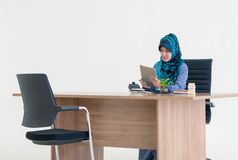 Muslim woman using digital tablet on office table stock images