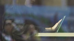 Muslim woman using tablet in cafe, communicating in social networks, surfing web. Stock footage stock footage