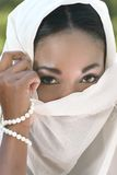 Muslim woman: veil on face. Muslim, Islamic woman: covering face with shawl or veil Royalty Free Stock Images