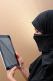 Muslim woman. Veiled middle eastern woman  with tablet Stock Photos