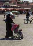 Muslim woman walking Royalty Free Stock Images