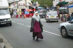 Muslim woman walking down street, Paris, France Royalty Free Stock Photo