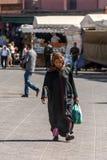 Muslim woman walking Royalty Free Stock Image