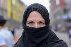 Muslim woman wearing a black hijab in town royalty free stock photography