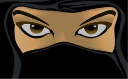 Muslim woman wearing a burka Stock Images