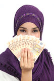 Muslim woman wearing a hijab holding a lot of money Royalty Free Stock Photography