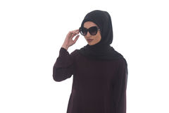 Muslim Woman Wearing Hijab And Sunglasses. Young Muslim Woman In Head Scarf With Modern Clothes And Sunglasses - Isolated On White Royalty Free Stock Images