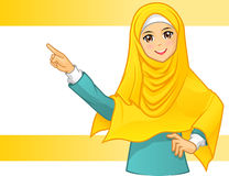Muslim Woman Wearing Yellow Veil with Pointing Arms Royalty Free Stock Image