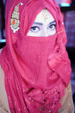 Muslim woman in wedding dress in simple backgound Stock Image