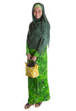 Muslim Woman With Yellow Handbag I stock photos