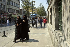 Muslim women. Two ypung Muslim girls walking the streets of Istanbul stock photography