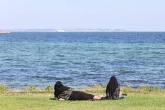 Muslim women at the beach. In Denmark Stock Photos