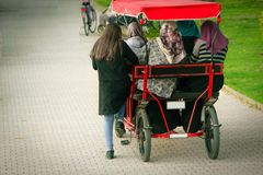 Muslim women driving a bicycle for five. In the city park Royalty Free Stock Photography