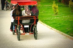 Muslim women driving a bicycle for five stock photo