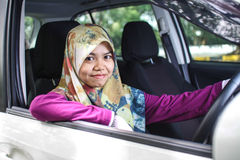 Muslim women driving a car. Potrait of muslim woman driving her car Royalty Free Stock Image