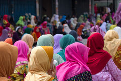 Muslim women during Friday Prayers in Kota Bharu, Malaysia. Muslim woman in colorful hijabs during Friday prayers in the Islamic City of Kota Bharu, Malaysia Royalty Free Stock Image