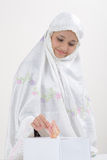 Muslim Women gives donation Stock Image