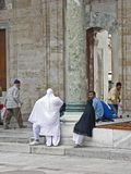 Muslim people in the mosque yard. Muslim women with headscarfes enter in the mosque yard Stock Photography