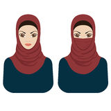 Muslim women in hijab and paranja. Royalty Free Stock Photography