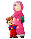 A muslim women hold her son head and ready to go to mosque Stock Images