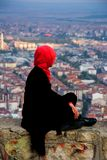 Woman looking at the city in the Afyonkarahisar Castle in Turkey. Muslim women looking from the Afyon castle to the Afyonkarahisar city Royalty Free Stock Image
