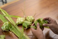 Women make traditional ketupat food for Eid celebrations at home. Muslim women make traditional ketupat food for Eid celebrations at home stock photos