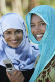 Muslim Women With Mobile Phone Stock Photography