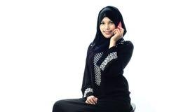 Muslim women on mobile phone smile. Muslim women on mobile phone and smile isolated white background Royalty Free Stock Photo