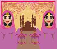 Muslim women on mosque background. Stock Image
