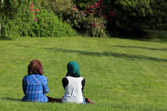 Muslim women in the park. Two muslim women enjoying sunny saturday afternoon in the park Stock Photos