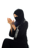 A muslim women pray looking down from side. In isolated white background Stock Image