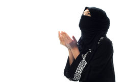 A muslim women pray looking up from side wide. In isolated white background Stock Photos