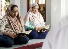 Muslim women reading from the Quran royalty free stock photos