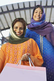 Muslim Women With Shopping Bag Stock Images