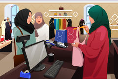 Muslim Women Shopping in a Clothing Store Stock Images