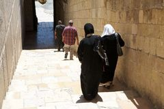 Muslim women. With traditional clothes are getting out from the mosque in Hebron where there are the tombs of Patriarchs. This is a holy place for both Muslim Royalty Free Stock Photography