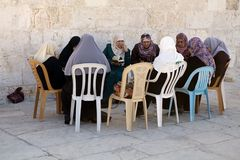 Muslim Women. With traditional clothes are reading the holy book at the Temple Mount, Jerusalem, Israel Stock Images